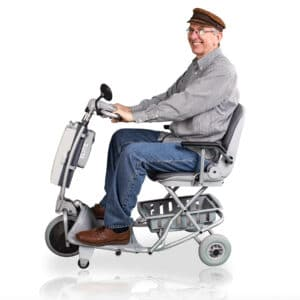 Man sat on the Elite mobility scooter in blue by tzora mobility scooters