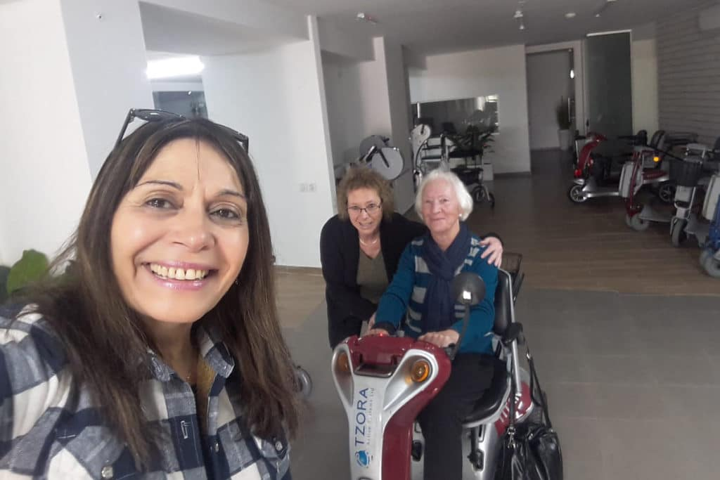 Why buy an old people scooter when you can get a Tzora! Grandaughter, Daughter and Mother selfie with Titan 4 in red