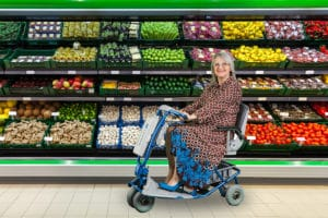 Lady on Lite Lexus in supermarket aisle
