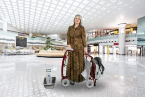 Lady with folding Classic Mobility Scooter in Shopping Centre